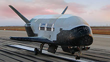 Wallpaper picture of X-37B landing.